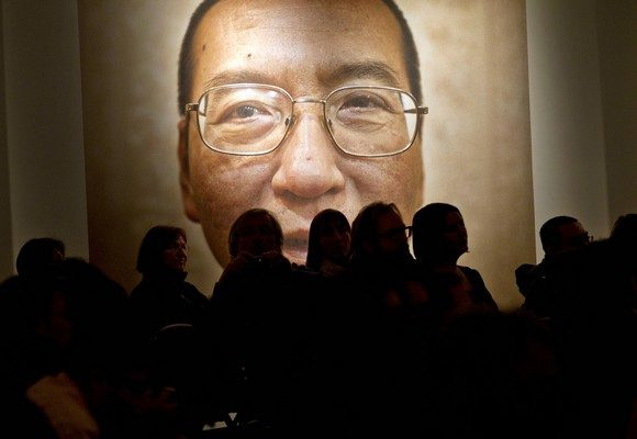 A picture of Liu Xiaobo seen inside the Nobel Peace Center on the day of The Nobel Peace Prize ceremony in Oslo on December 10, 2010. The head of the Nobel committee placed this year's peace prize on an empty chair as Beijing raged against the award to dissident Liu Xiaobo, who is languishing in a Chinese prison cell. AFP PHOTO / DANIEL SANNUM LAUTEN (Photo credit should read DANIEL SANNUM-LAUTEN/AFP/Getty Images)