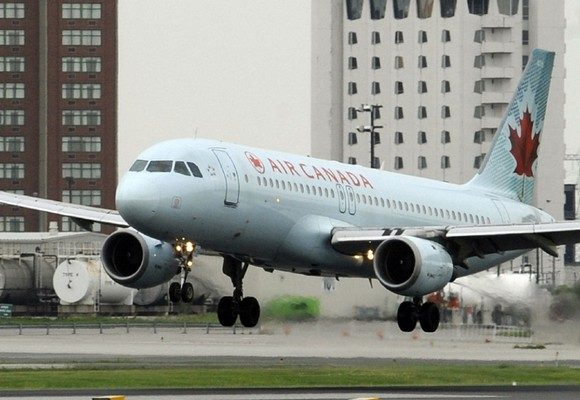 An Air Canada Airbus A320 - 200 lands on runway 24R at Pearson Airport this morning. TONY BOCK/TORONTO STAR  (JUNE 19, 2010)